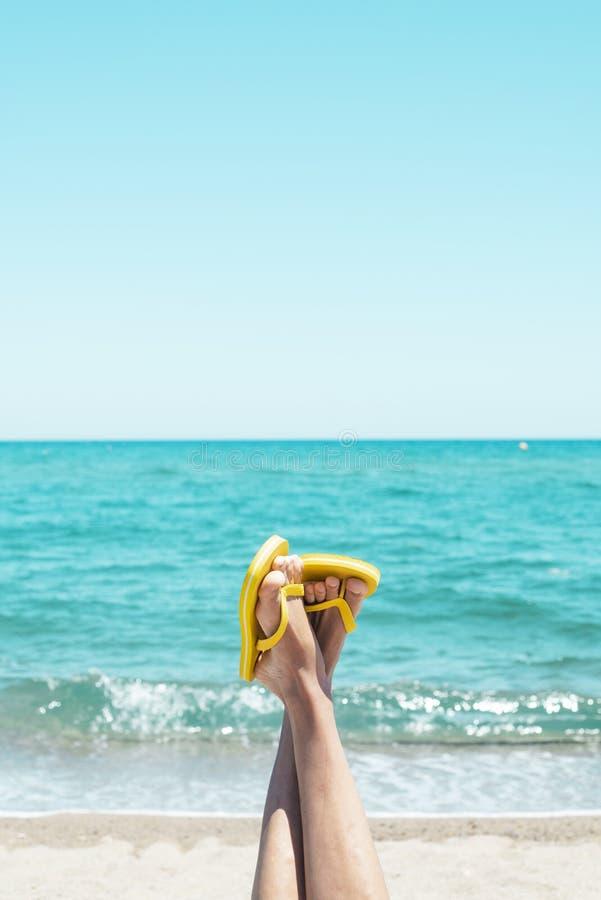 Man upside down wearing flip-flops on the beach royalty free stock image