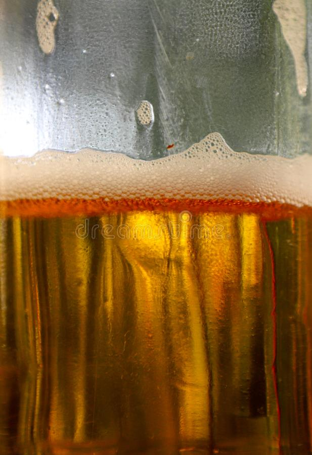 Closeup of light beer and beer bubbles in a plastic bottle stock photo
