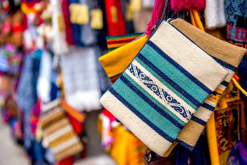 Closeup of light striped handbags on the souvenir store in Bolivia. Closeup of light striped handbags with weaves on the souvenir store in Bolivia royalty free stock photo
