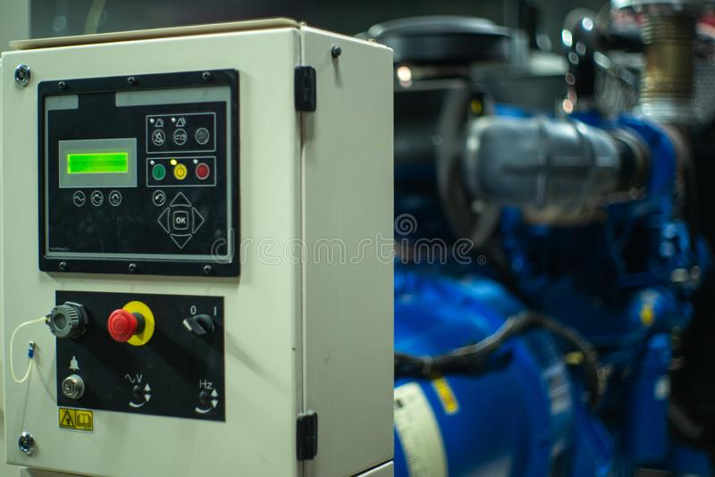 Closeup lighting indicator on the control cabinet in the electrical room with blurred electrical generator in background.  stock image