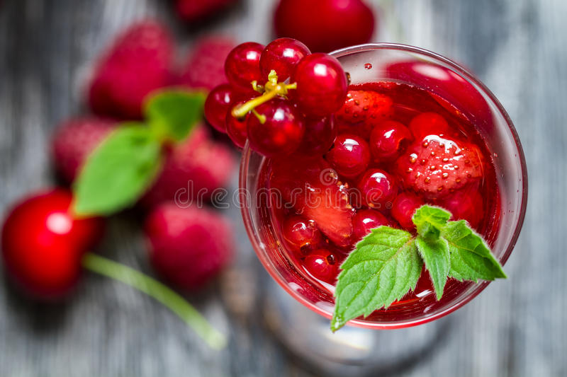 Closeup of liqueur made of wild berries and mint royalty free stock photos