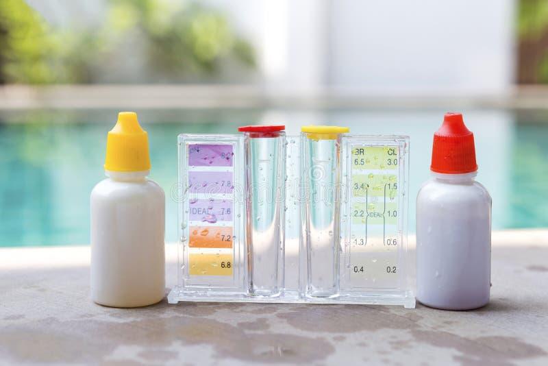 Closeup liquid swimming pool water testing test kit stock photos