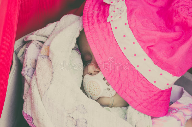 Closeup of little baby covered with pink hat. stock photo