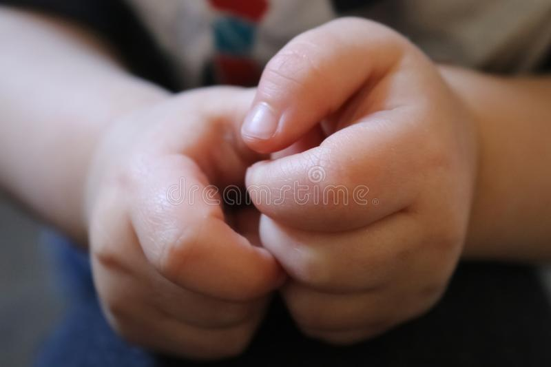 Closeup of a little boys hands with blurry backgound royalty free stock images