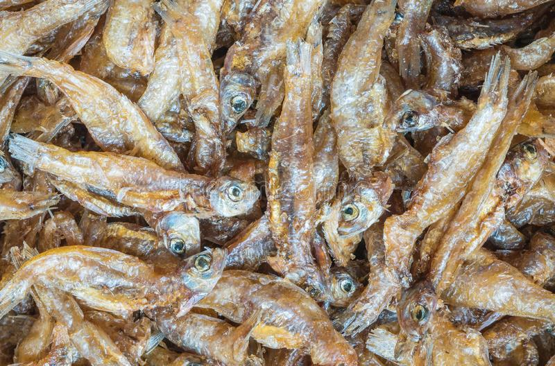 Closeup little fried fish texture background royalty free stock image