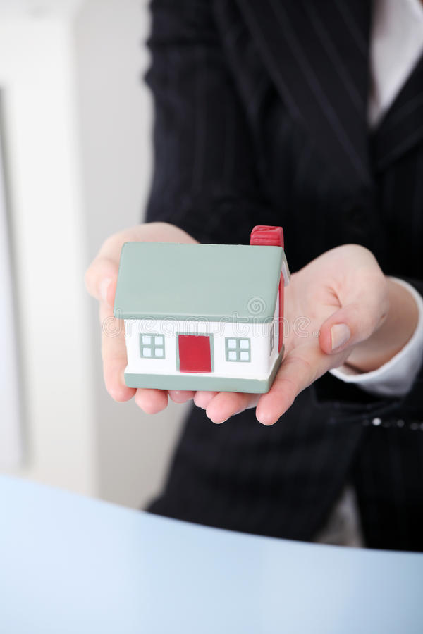 Closeup on little house model. Closeup on little house model in woman`s hands stock image