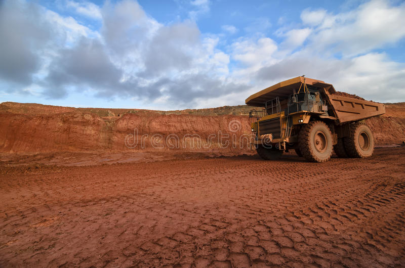 Closeup of a loaded tip-truck in an open mine stock photography