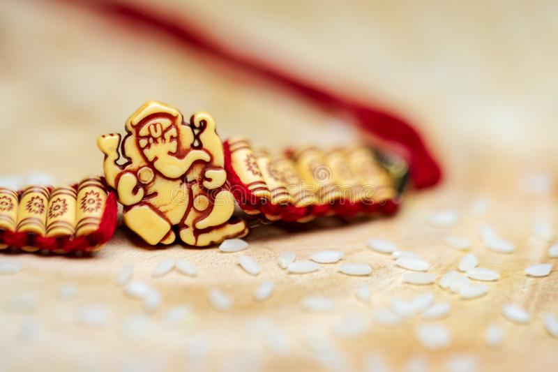 Closeup Of Lord Ganesha Wristband On A Wooden Surface stock image