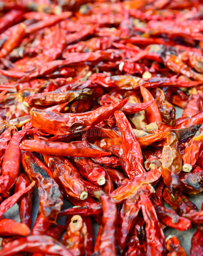 Closeup of low-grade dried red peppers. Selective focus with blur foreground and background royalty free stock images