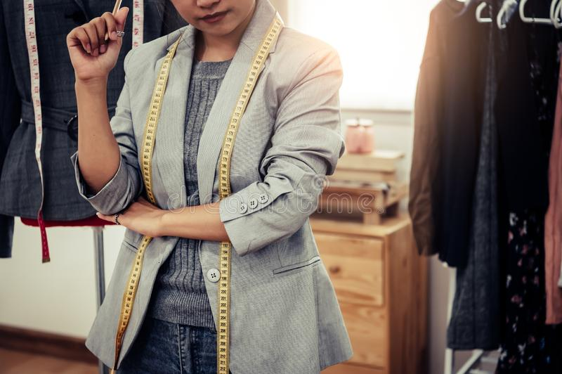 Closeup of lower body of fashion stylist designer in business owner workshop. Tailor and sewing concept. Portrait of happy casual royalty free stock photo