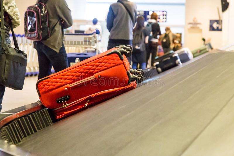 Closeup of luggage bag on airport conveyor belt for pickup. At airport royalty free stock photography