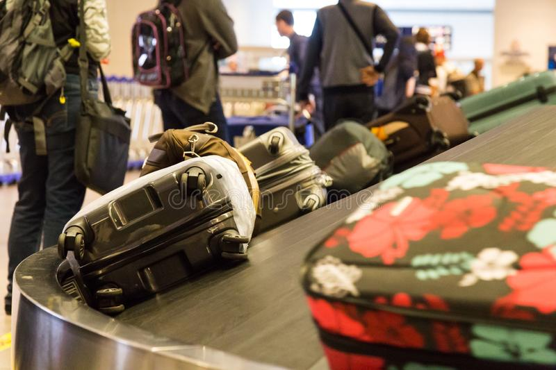 Closeup of luggage bag on airport conveyor belt for pickup. At airport terminal stock photography