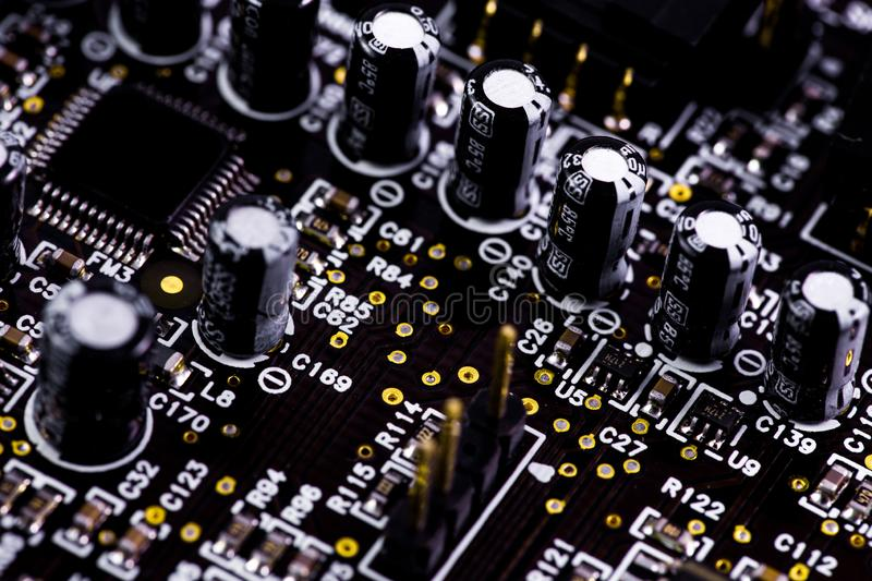 Closeup macro motherboard, circuit board. Electronic computer hardware technology royalty free stock photography