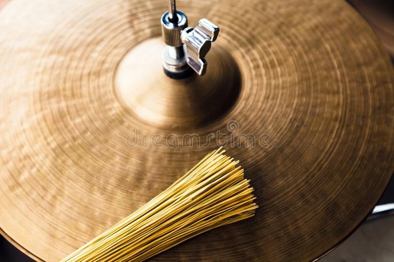 Closeup macro hi hat cymbal and brush. Concept concert, live music, performance, musical evening in a restaurant royalty free stock photos
