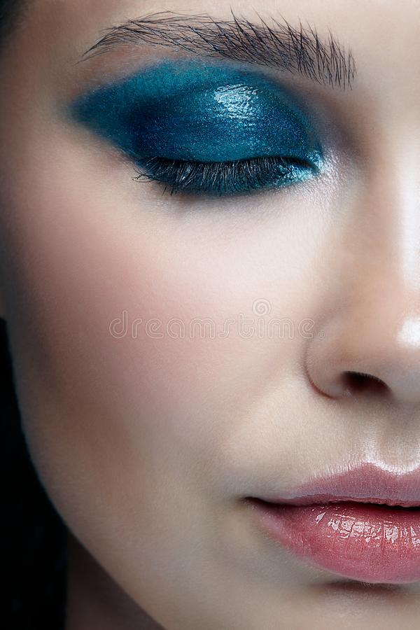 Closeup macro portrait of female face with closed eyes. Human woman half-face with evening beauty makeup. stock image