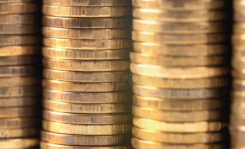Stack of metal golden coins. Closeup macro stack of metal golden coins royalty free stock images