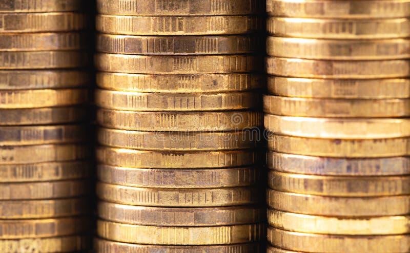 Stacks of metal coins. Closeup macro stacks of metal coins royalty free stock photos