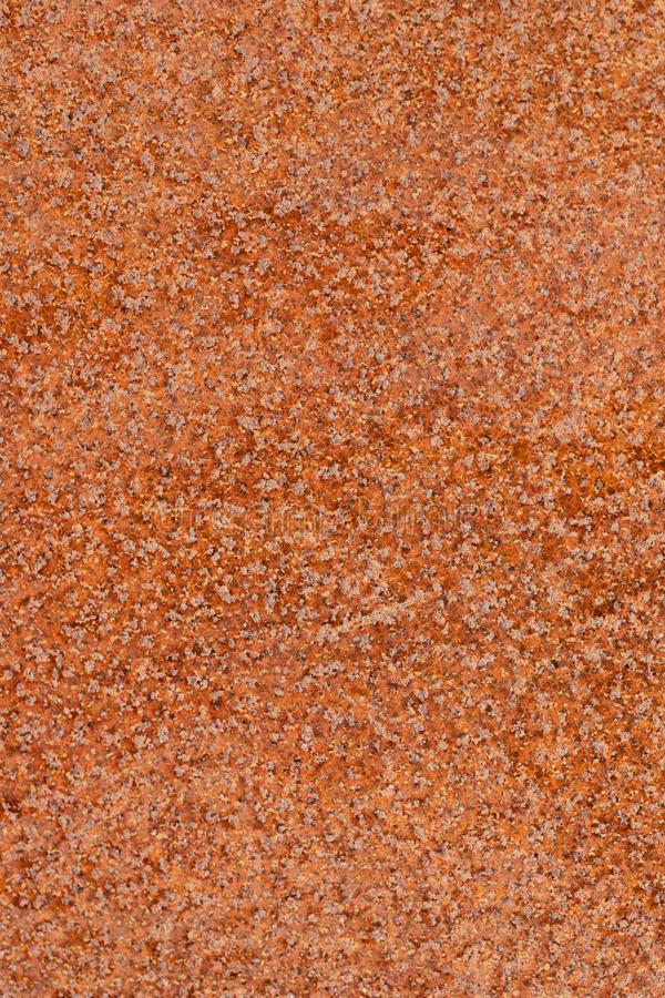 Closeup macro view of flecked old rusty metal surface yellow and orange color stock photography