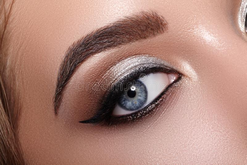 Closeup Macro of Woman Face with Cat-Eyes Make-up. Fashion Celebrate Makeup, Glowy Clean Skin, perfect Shapes of Brows stock photography