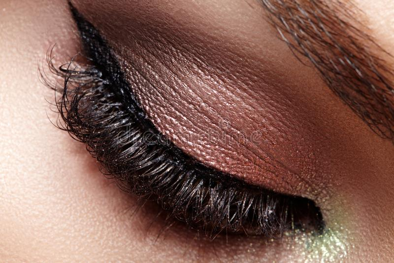 Closeup Macro of Woman Face with Eyes Make-up. Fashion Celebrate Makeup, Glowy Clean Skin, Extra Long Eyelashes.  stock photo