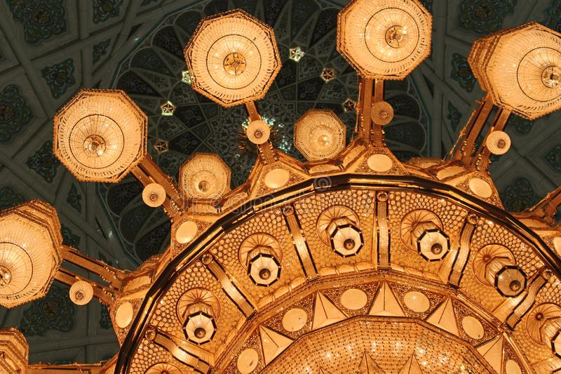 Closeup of the Main Chandelier of the Sultan Qaboos Grand Mosque. The largest chandelier in the world adorns the Sultan Qaboos Grand Mosque in Muscat, Oman. It stock image