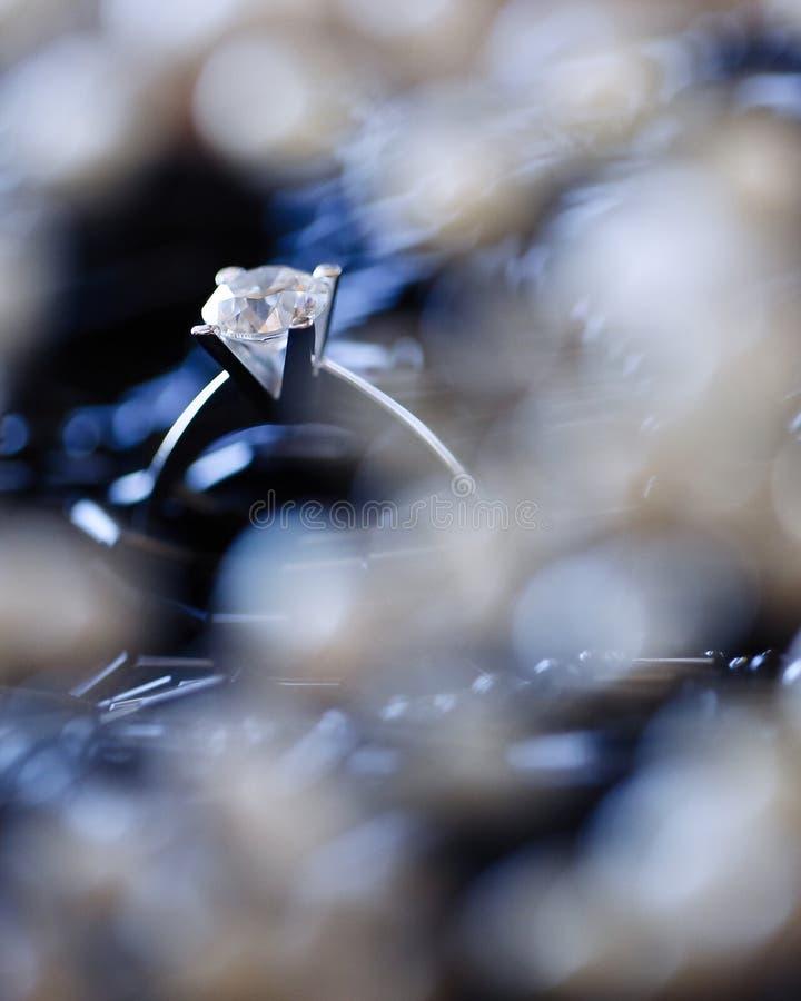 Closeup makro photo shooting Big expensive wedding ring stock photo