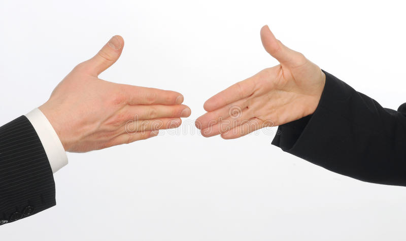 Closeup of male and female executives about to sha. Ke hands on white background stock photos
