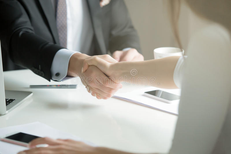 Closeup of male and female hands handshaking after effective neg royalty free stock photo
