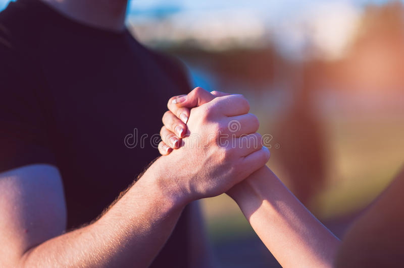 Closeup of male and female handshake outdoors stock image
