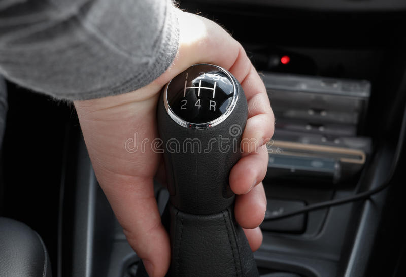 Closeup of male hand on gearshift stick stock photos