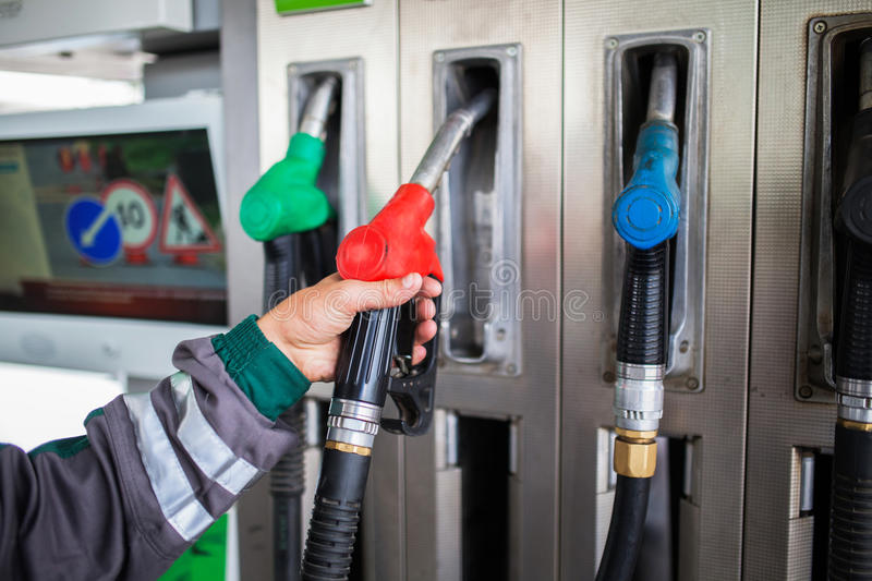 Closeup of male hand holding gas pump royalty free stock photo