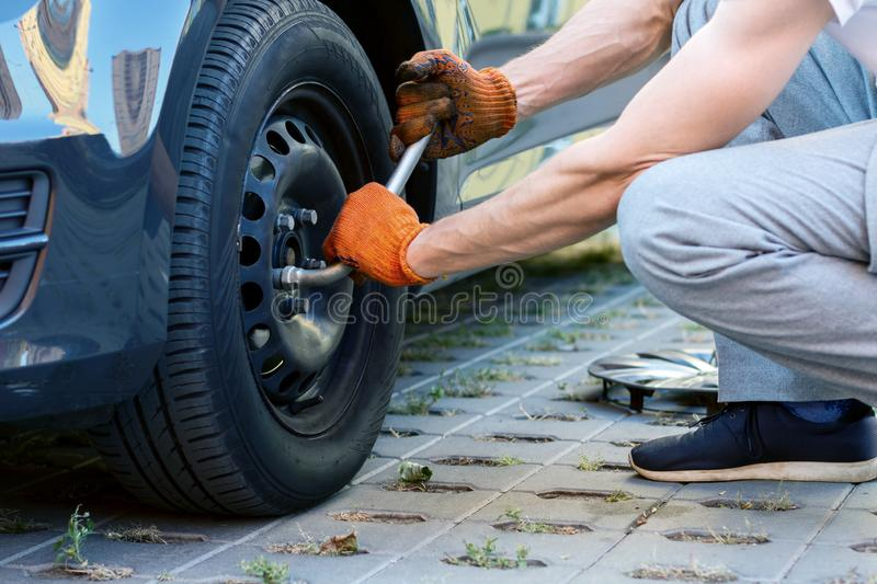 Young driver repairing car on street stock images