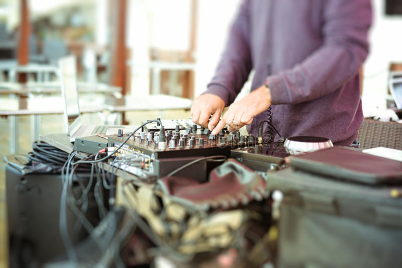Closeup of male hands mixing audio with royalty free stock images
