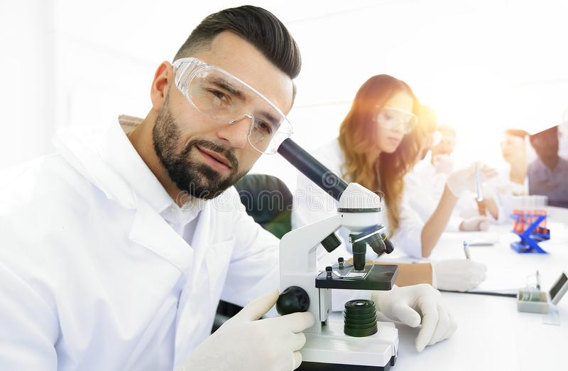 closeup of male technician sitting at his working in the laborat stock images