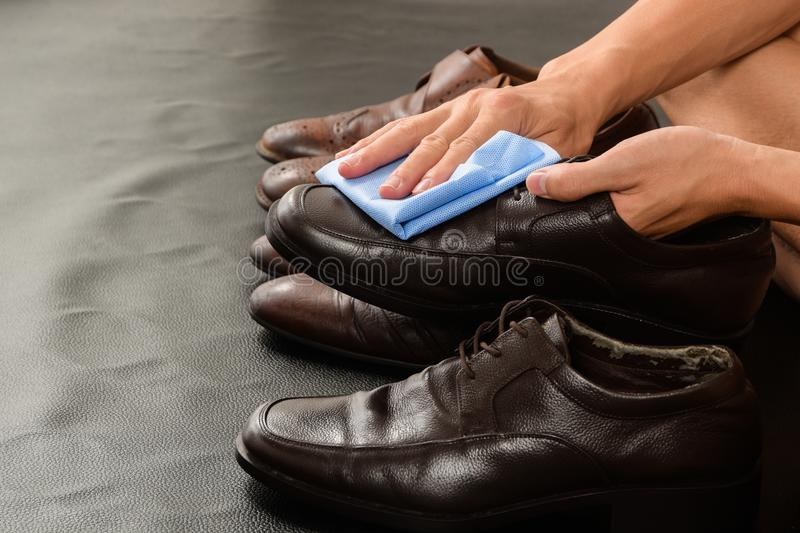 Closeup of Man Cleaning His Leather Shoes royalty free stock photo