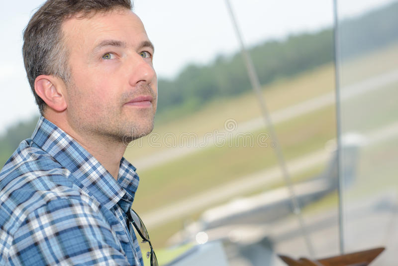 Closeup man in control tower. Closeup of man in control tower royalty free stock photos