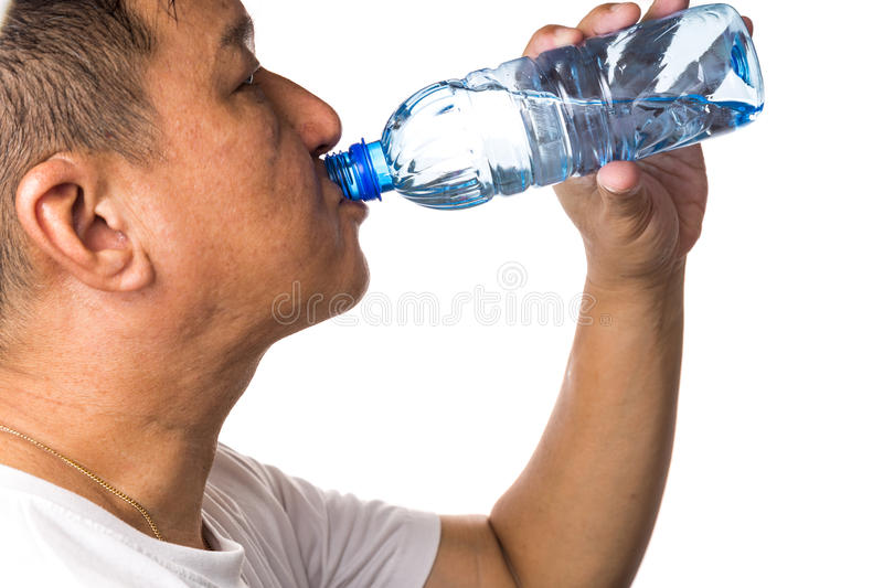 Closeup of man drinking refreshing cold water from bottle. With white background stock images