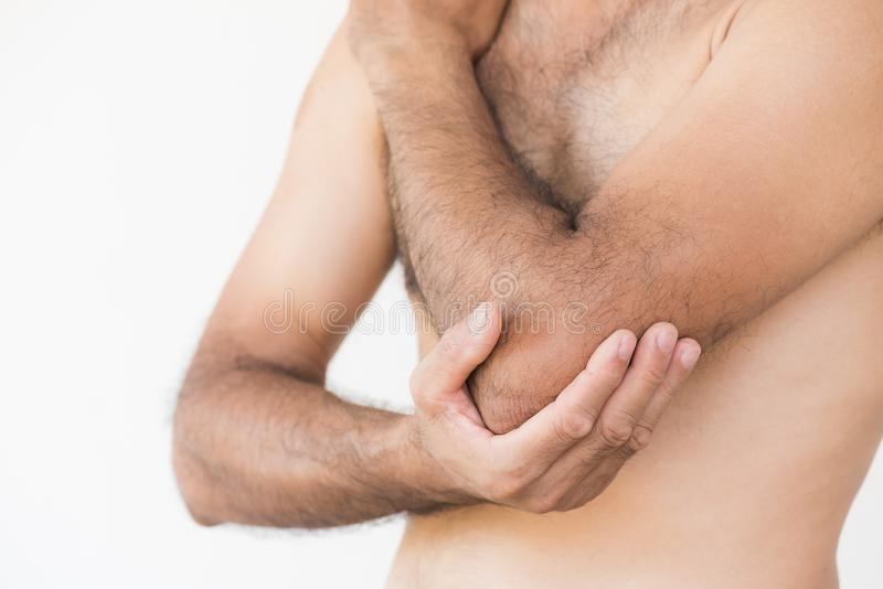 Closeup man elbow and arm pain and injury on white background. stock images