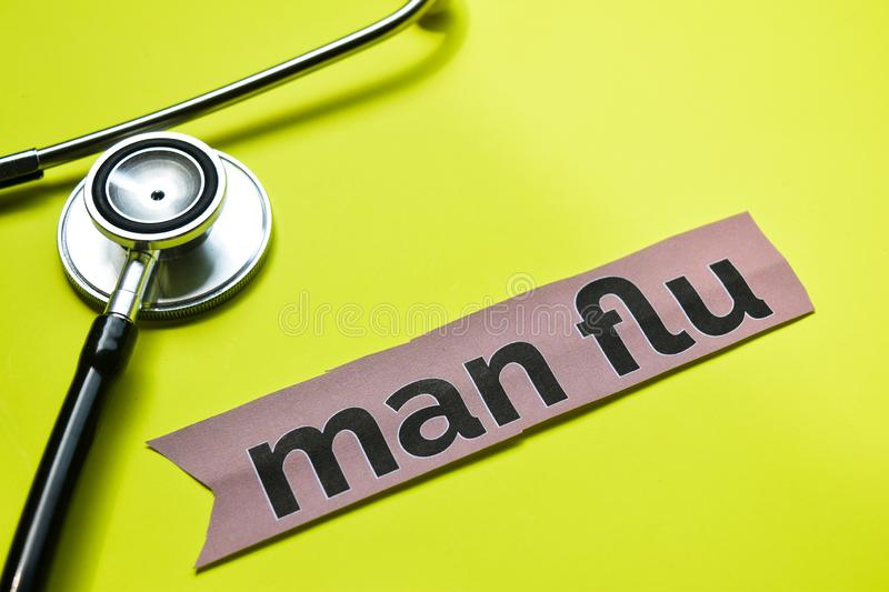 Closeup man flu with stethoscope concept inspiration on yellow background royalty free stock image