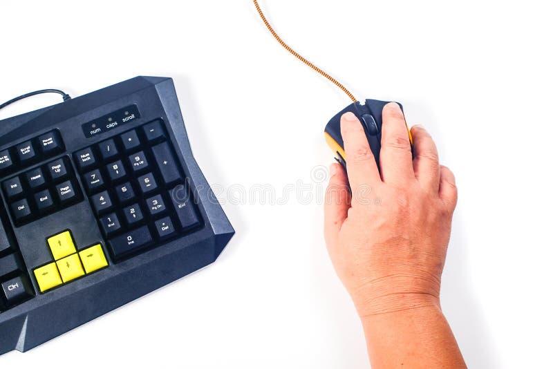 closeup of man hand clicking computer mouse stock photos