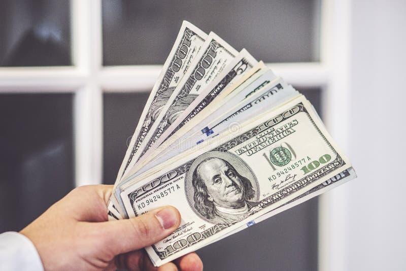 Closeup of man hands count us dollar money stock image