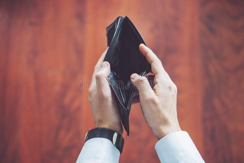Closeup of man hands, and empty wallet in male hands royalty free stock image