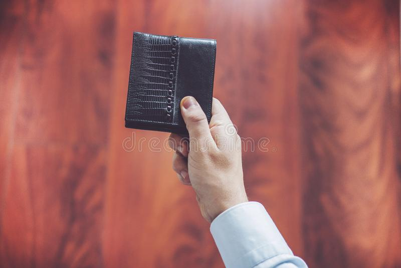 Closeup of man hands, man holds out wallet in hand. Business concept royalty free stock images