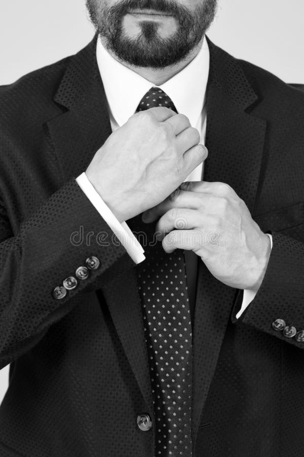 Closeup of man hands take tie. Close up hands tie knot on white shirt royalty free stock photos