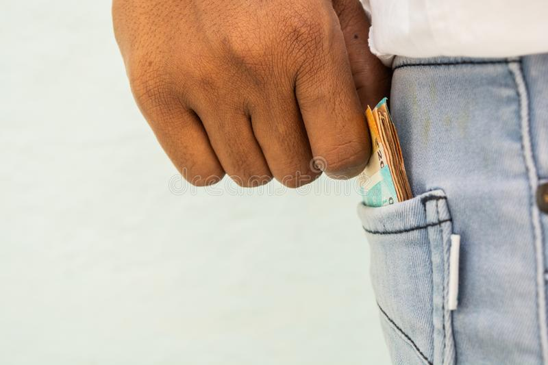 Closeup of Man hands taking currency notes form his pocket royalty free stock photos