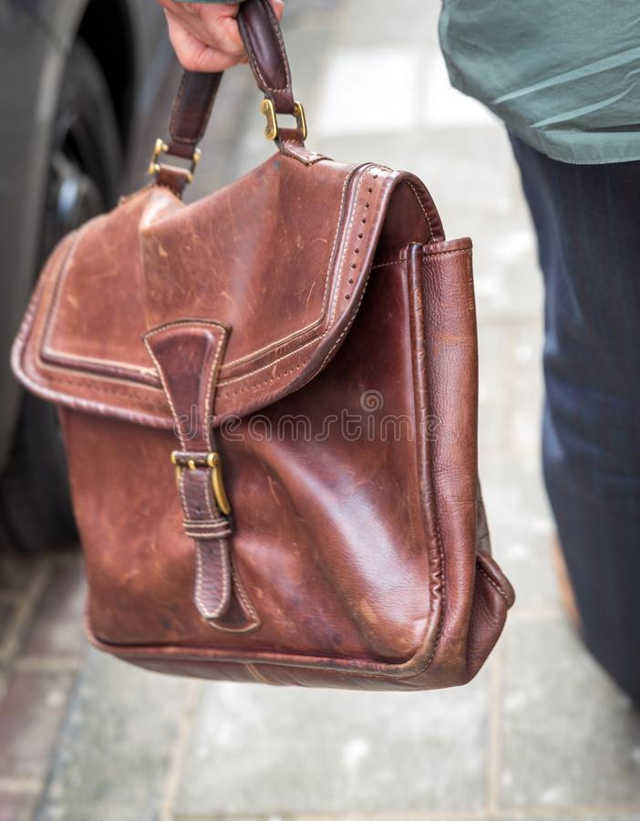 Closeup of man holding casual leather Briefcase Going To Work stock photos