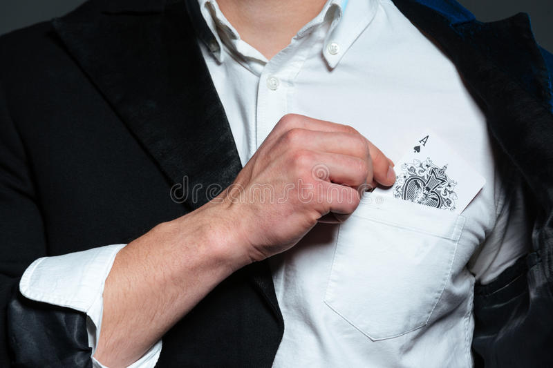 Closeup of man magician with ace in his pocket royalty free stock photo