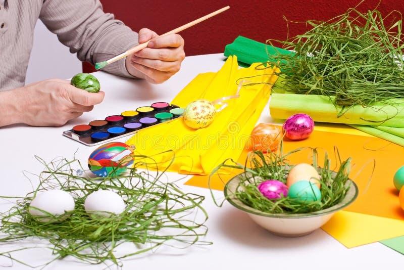 Closeup man painted Easter eggs stock photos
