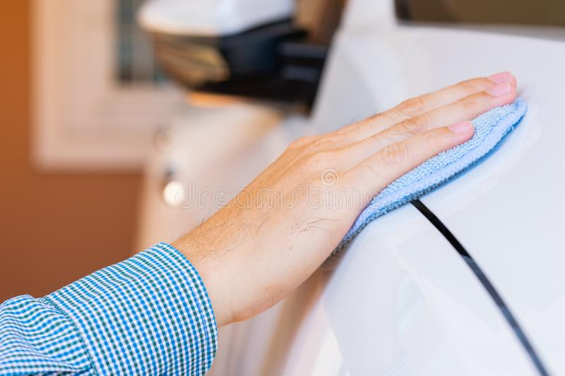 Closeup for man polishing cleaning car with microfiber cloth stock image