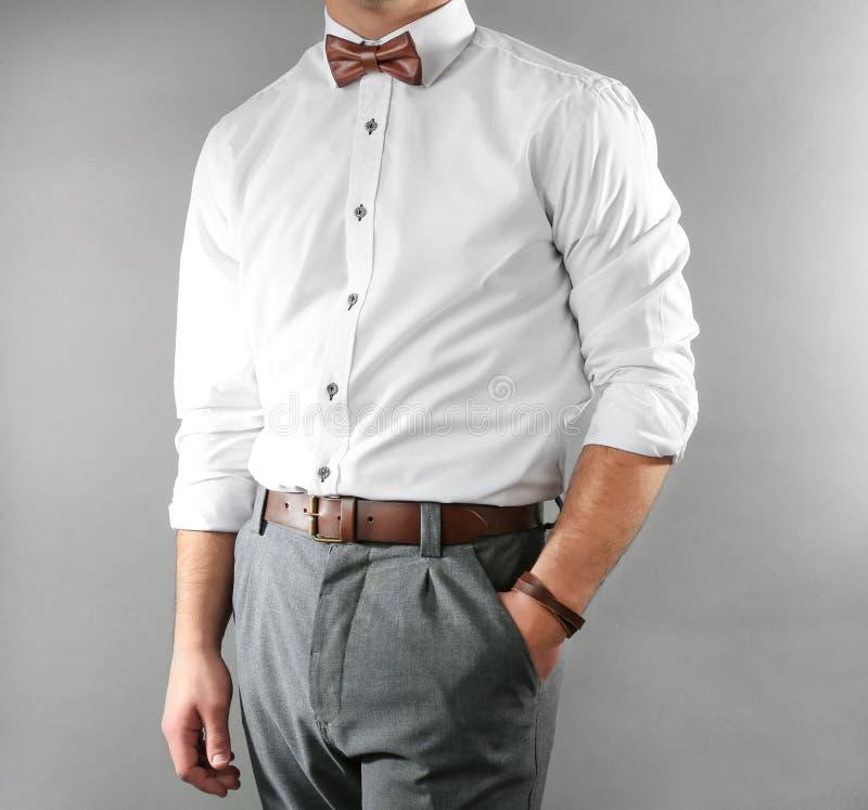 Closeup of man in stylish clothing on background stock photo